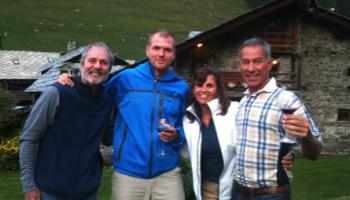 Guide and clients enjoying drinks on the tour of Monte Rosa