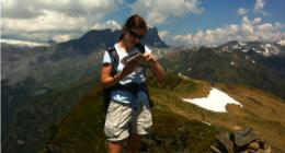 Checking the map on a self-guided trekking trip in the Alps